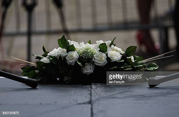 A wreath of white rises is placed on the stage as hundreds of people attend a public event to celebrate the life and 42nd birthday of Labour MP Jo...