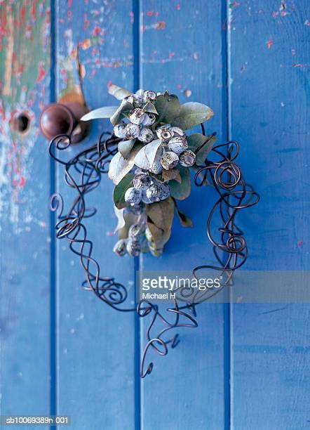 Wreath of wire with eucalyptus on blue door