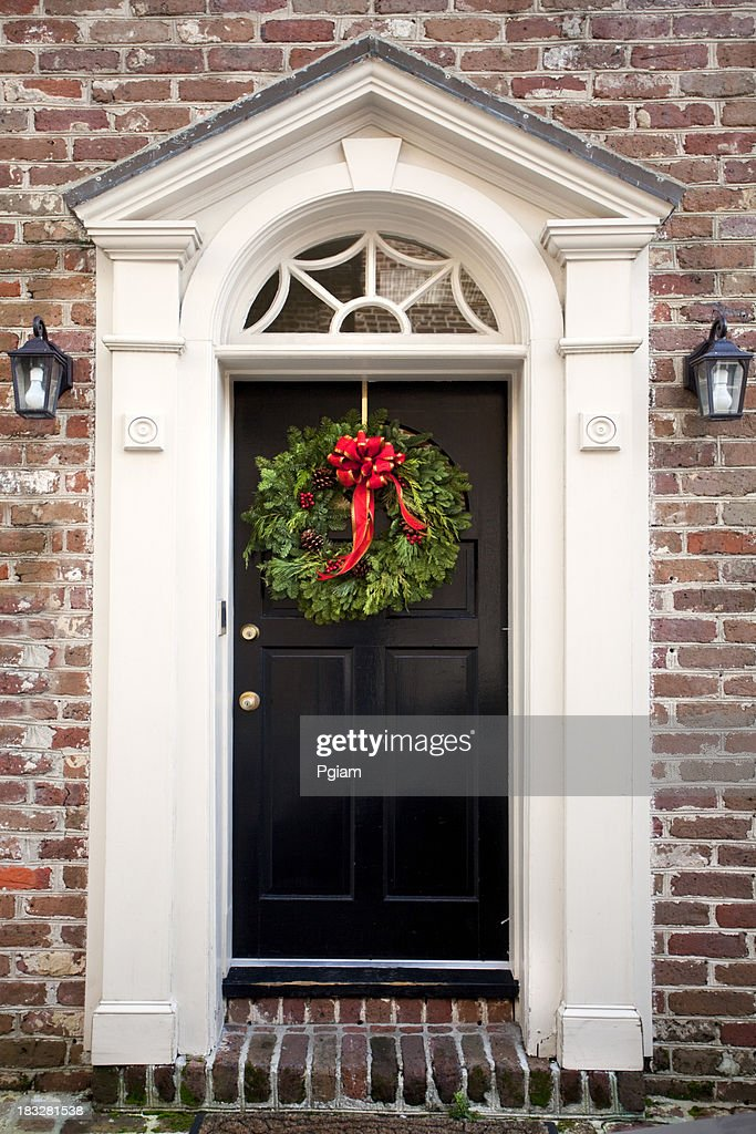 Red entrance door in front of residential house stock photo - Wreath On A Front Door Stock Photo Getty Images