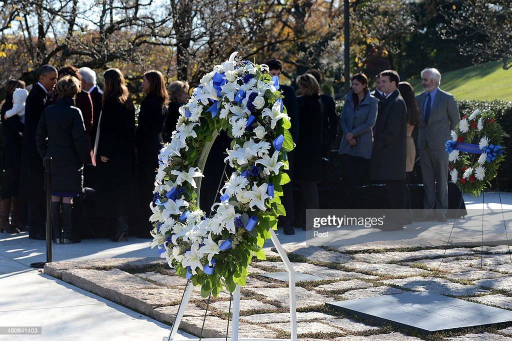 A wreath stands at the grave site of President John F. Kennedy as U.S. President <a gi-track='captionPersonalityLinkClicked' href=/galleries/search?phrase=Barack+Obama&family=editorial&specificpeople=203260 ng-click='$event.stopPropagation()'>Barack Obama</a> (L) talks with members of the Kennedy family after a wreath laying ceremony at the grave site for President John F. Kennedy at Arlington National Cemetery November 20, 2013 in Arlington, Virginia. The 50th anniversary of the assassination of John F. Kennedy will be marked on November 22.