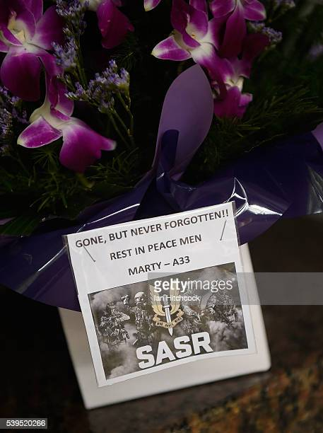 A wreath with a card is seen laying at the Black Hawk memorial during a memorial service to mark the twentieth anniversary of the Black Hawk...