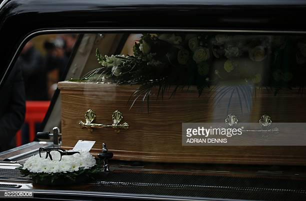 A wreath with a note attached lies in the hearse carrying the coffin of British comedian Ronnie Corbett to his funeral in Croydon on April 18 2016...