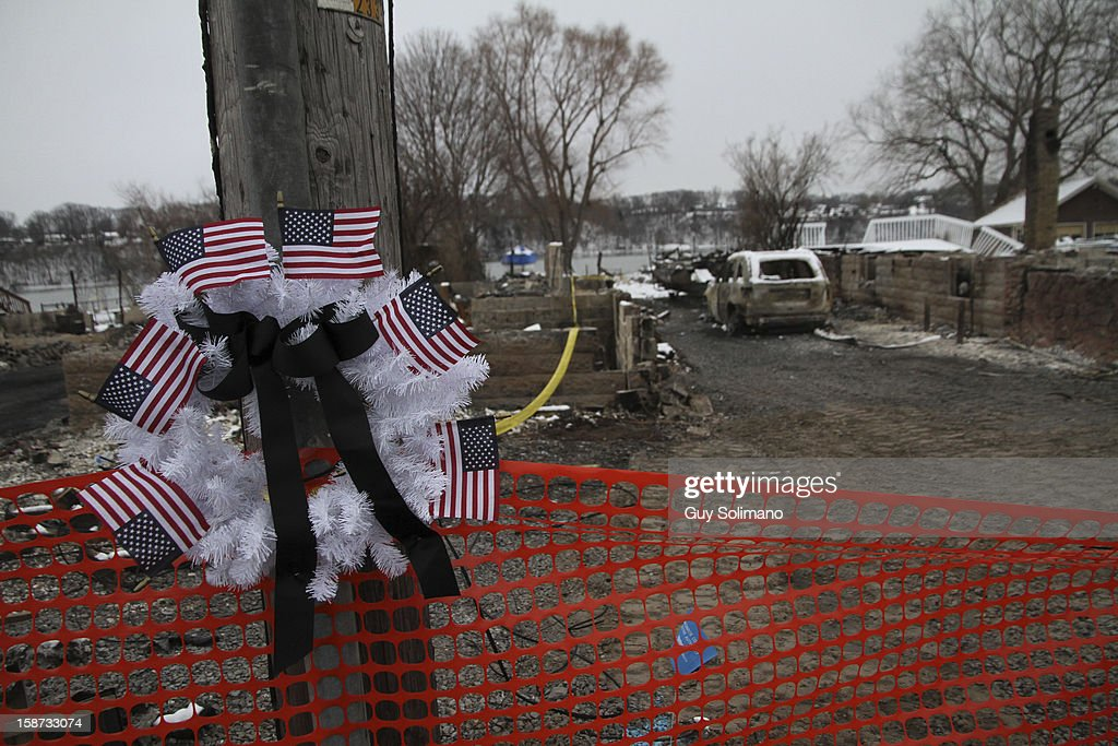 A wreath with American flags hangs on a pole at the site of the Christmas eve shooting and fires on Wednesday, December 26, 2012 in Webster, New York. Law enforcement officials have not publicly identified which gun or guns were used to shoot the four firefighters, two of them fatally, or in what authorities have described as a brief standoff between William Spengler Jr., and a Webster police officer on Christmas eve.