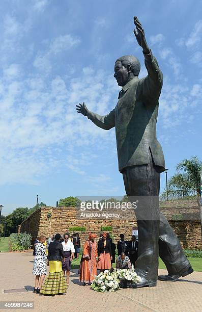 A wreathlaying ceremony is held in front of the Mandela's Statue in Pretoria during the first anniversary of former President and Nobel peace...