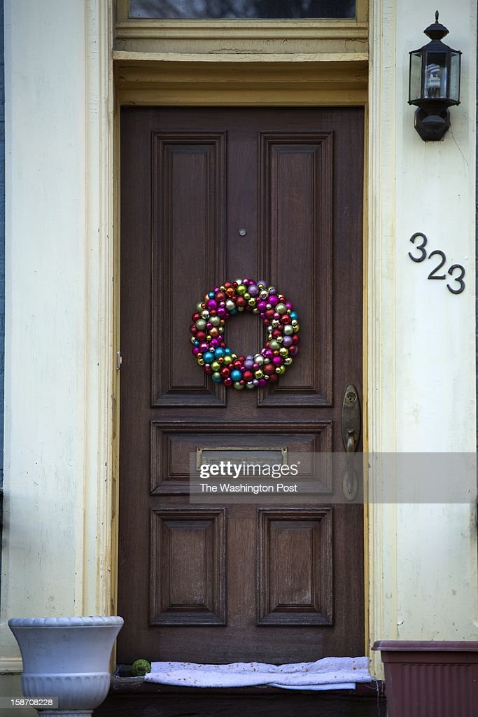 Wreaths adorn doors and windows on residences in the Capitol Hill neighborhood of Washington, DC on Dec. 18.