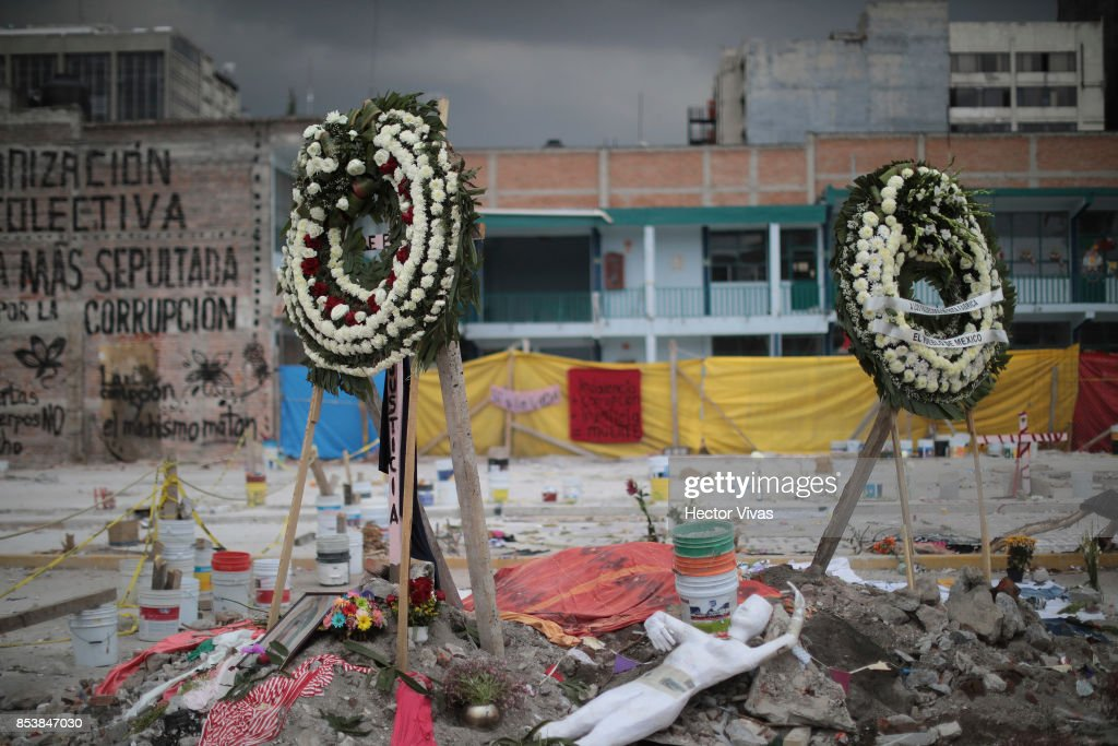 Wreaths and personal objects of the people who died are seen in the collapsed sewing factory at Colonia Obrera six days after the magnitude 7.1 earthquake jolted central Mexico killing more than 300 hundred people, damaging buildings, knocking out power and causing alarm throughout the capital on September 25, 2017 in Mexico City, Mexico.