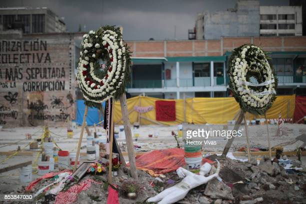 Wreaths and personal objects of the people who died are seen in the collapsed sewing factory at Colonia Obrera six days after the magnitude 71...
