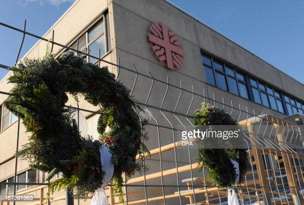 Wreaths are fixed on a fence in front of a workshop for disabled people in Titisee Neustadt southern Germany on December 1 2012 An oecumenical...