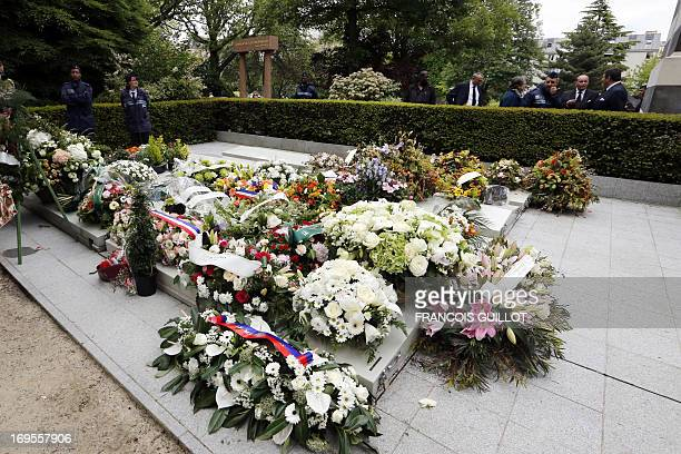 Wreaths are laid out on May 27 2013 during the funeral of French singer and composer Georges Moustaki at the Pere Lachaise cemetery in Paris Born on...
