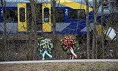 TOPSHOT Wreaths are pictured on the train crash site on February 10 2016 near Bad Aibling German investigators raced to determine whether human error...