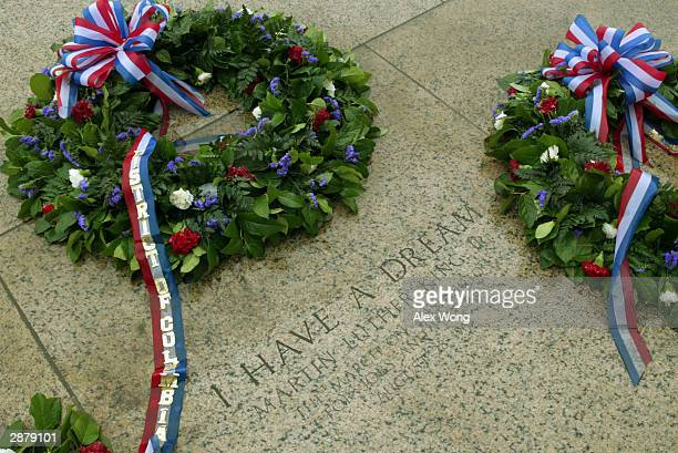 Wreaths are placed next to a stone inscription that marks the spot where Dr Martin Luther King Jr made his 'I Have a Dream' speech as visitors walk...