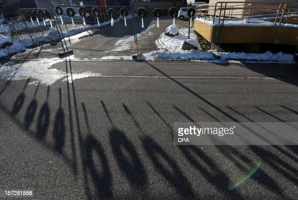 Wreaths fixed on a fence in front of a workshop for disabled people cast their shadows in Titisee Neustadt southern Germany on December 1 2012 An...