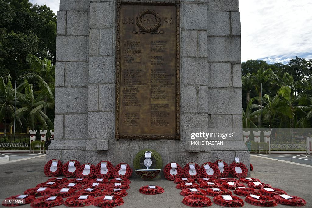 Wreaths sit in front of the cenotaph after a service of remembrance ceremony by the Royal Commonwealth Ex-Services League (RCEL) for those killed in war, at the National Monument in Kuala Lumpur on June 26, 2016. The Royal Commonwealth Ex-Services League (RCEL) is a Commonwealth charity with 57 member organisations in 50 Commonwealth countries, including Malaysia. Malaysia was chosen to be the host of its 32nd conference from June 26 to 29. / AFP / MOHD