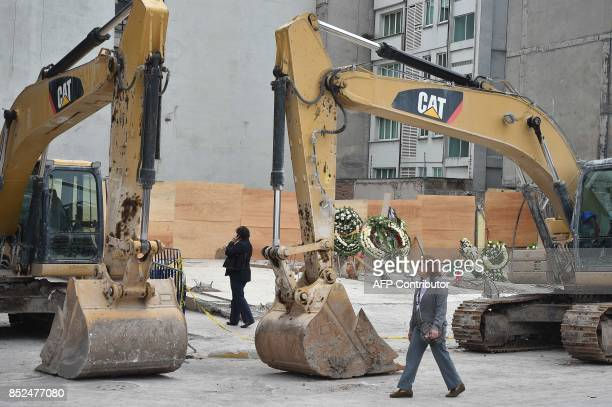 Wreaths were placed to honor the dead on the site where a building was flattened by a strong 71magnitude quake four days ago in Mexico City on...