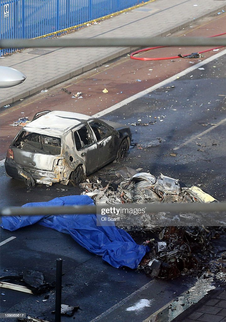 Wreckage at the scene after a helicopter reportedly collided with a crane attached to St Georges Wharf Tower in Vauxhall, on January 16, 2013 in London, England. According to reports, the helicopter hit the crane before plunging into the road below during the morning rush hour.