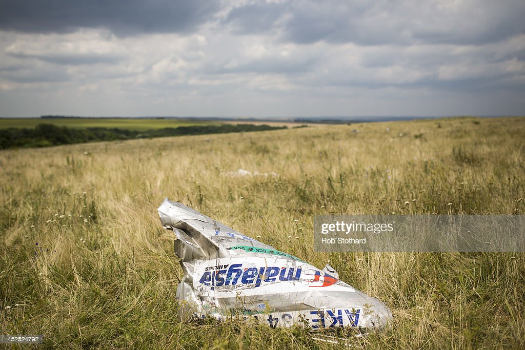 Wreckage from Malaysia Airlines flight MH17 lies in a field on July 22, 2014 in Grabovo, Ukraine. Malaysia Airlines flight MH17 was travelling from Amsterdam to Kuala Lumpur when it crashed killing all 298 on board including 80 children. The aircraft was allegedly shot down by a missile and investigations continue over the perpetrators of the attack.