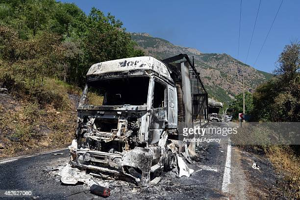 Wreckage of 4 trailer and 1 excavator which have been set on fire by the PKK terrorists are seen in Tunceli Turkey on August 01 2015