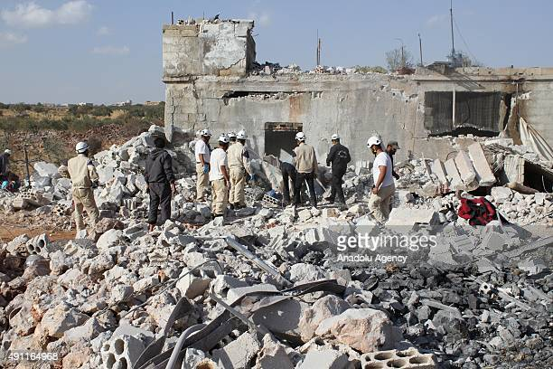 Wreckage of buildings are seen at the site of the alleged Russian airstrikes targeting the Jabal alZawiya town of Idlib Syria on October 03 2015