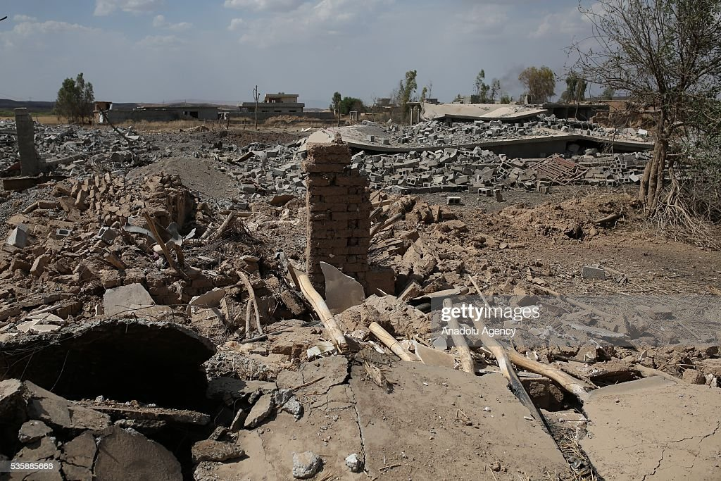 Wreckage of buildings is seen as Peshmerga forces conduct an operation against Daesh terrorists in Nineveh, Iraq on May 30, 2016.
