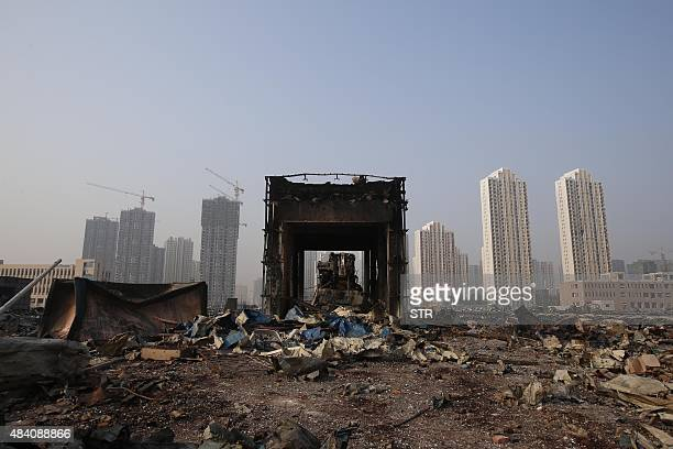 Wreckage of containers are seen at the site of the explosions in Tianjin on August 15 2015 Residents near the site of two giant explosions in the...