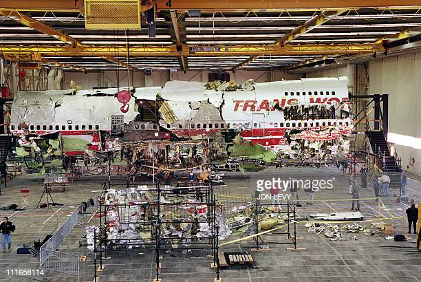 Wreckage of the front portion of the TWA flight 800 Boeing 747 aircraft is displayed in its reconstructed state 19 November 1997 in Calverton Long...