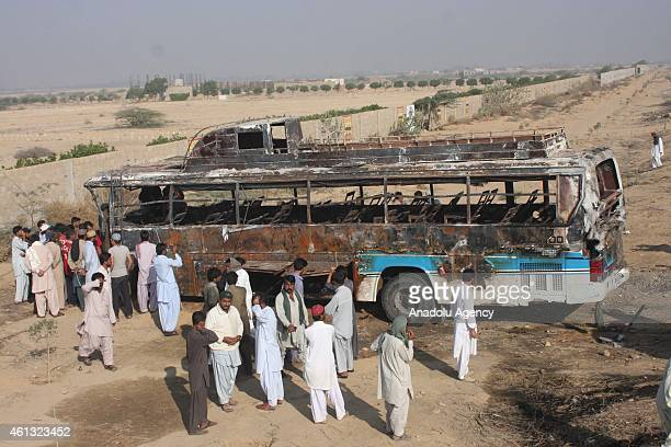 Wreckage of the passenger bus is seen following an accident along the Super Highway near Karachi early on January 11 2015 At least 59 people were...