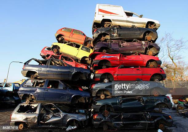 Wreckages of cars are piled up at a scrap yard on January 19 2009 in Hamburg Germany Germany unveiled a new 50 billion euro stimulus package on...