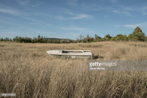 A wrecked boat sits on the dried bed of Entrepenas reservoir second largest water reservoir feeding the Segura River and Spain's Southeastern regions...