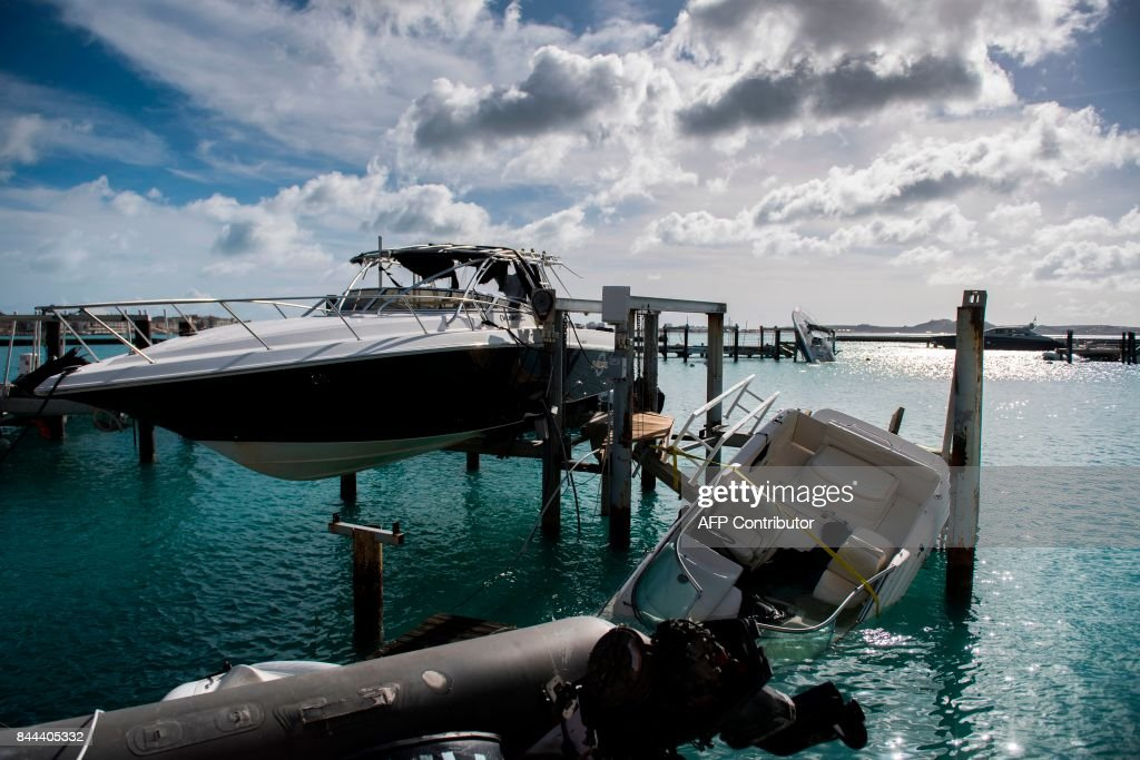 TOPSHOT - Wrecked boats are seen at the Fort Louis Marina in Marigot on September 8, 2017 in Saint-Martin island, devastated by Hurricane Irma. Officials on the island of Guadeloupe, where French aid efforts are being coordinated, suspended boat crossings to the hardest-hit territories of St. Martin and St. Barts where 11 people have died. Two days after Hurricane Irma swept over the eastern Caribbean, killing at least 17 people and devastating thousands of homes, some islands braced for a second battering from Hurricane Jose this weekend. / AFP PHOTO / Martin BUREAU