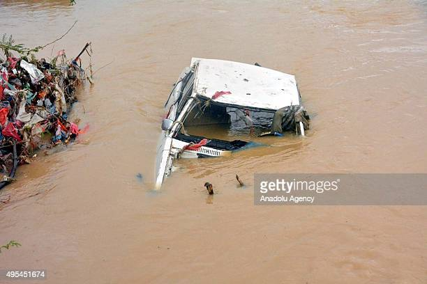 A wrecked car is seen through wind and heavy raincaused floodwaters as a result of Cyclone Chapala generated in the Arabian Sea on the shore of...