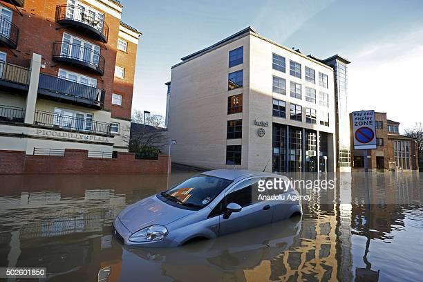 A wrecked car on a flooded street is seen in York city centre England on December 27 2015 Heavy rain caused the river to burst it's banks on Boxing...