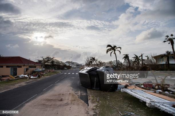 TOPSHOT A wrecked car remains on the road of Baie Nettle area of Marigot on September 10 2017 on SaintMartin island devastated by Hurricane Irma...
