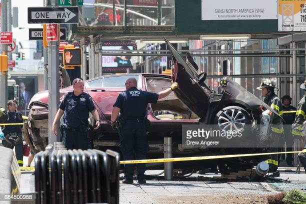 A wrecked car sits in the intersection of 45th and Broadway in Times Square May 18 2017 in New York City According to reports there were multiple...