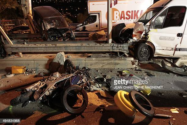 Wrecked cars and vans are pictured after a road crash at a toll gate on the A8 highway near Nice southeastern France on October 29 2015 A car...
