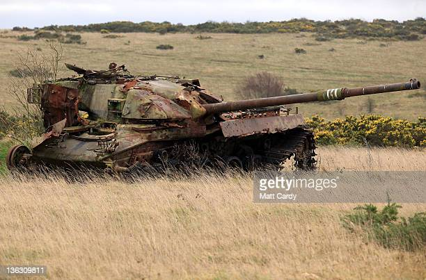 Wrecked tanks are seen close to the road that leads to the village of Imber on December 31 2011 on Salisbury Plain England The church of St Giles...