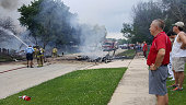 Wrekage from a plane crash burns near Bedord Drive and Pembrook Court Thursday July 21 2016 in Plainfield Ill The pilot and any passengers who may...