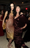 L'Wren Scott and Anjelica Huston attend the 2011 Vanity Fair Oscar Party Hosted by Graydon Carter at the Sunset Tower Hotel on February 27 2011 in...