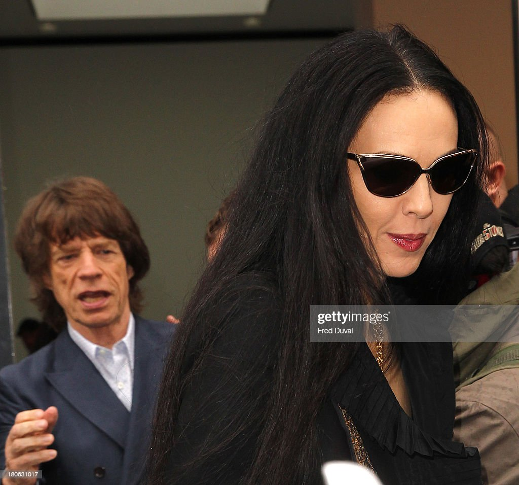 L'Wren Scott and Mick Jagger are sighted during London Fashion Week on September 15, 2013 in London, England.