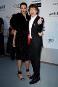 L'Wren Scott and Mick Jagger arrive at amfAR's Cinema Against AIDS 2010 benefit gala at the Hotel du Cap on May 20 2010 in Antibes France