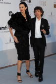 L'Wren Scott and Mick Jagger arrives at amfAR's Cinema Against AIDS 2010 benefit gala at the Hotel du Cap on May 20 2010 in Antibes France