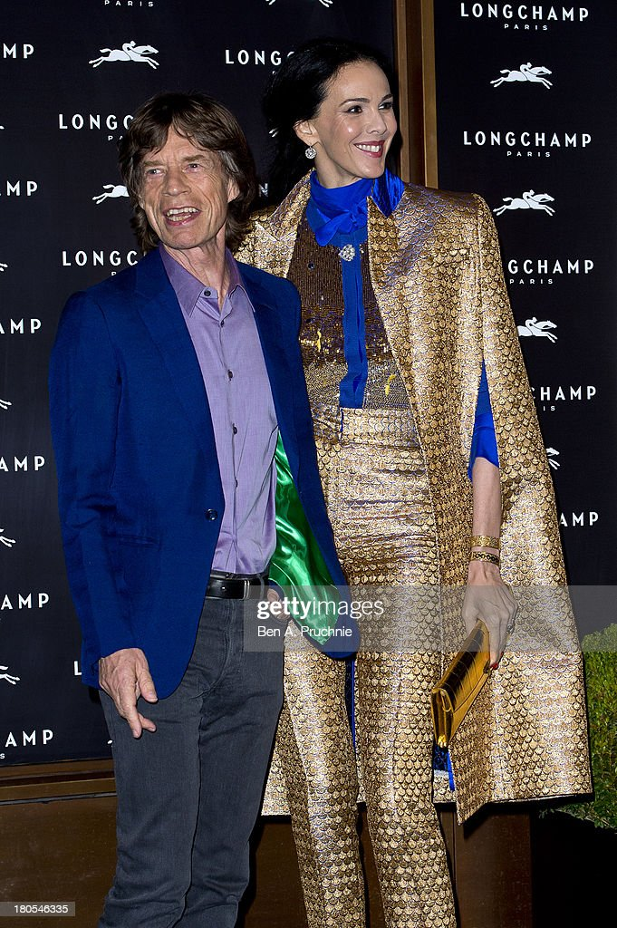 L'Wren Scott and Mick Jagger attend the grand opening party of Longchamp Regent Street on September 14, 2013 in London, England.