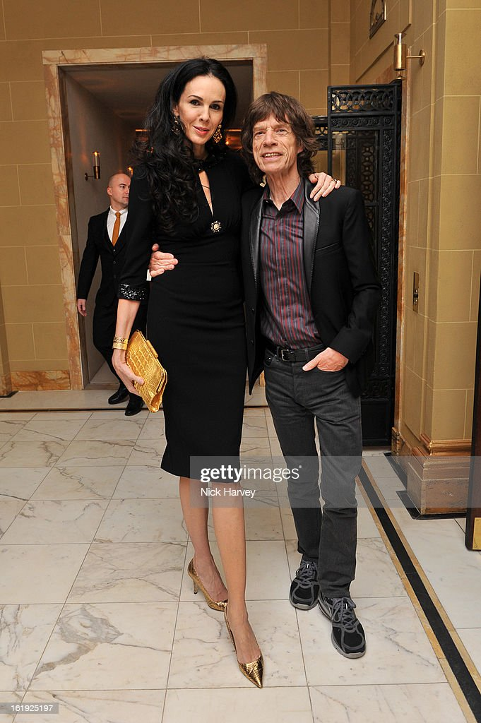 <a gi-track='captionPersonalityLinkClicked' href=/galleries/search?phrase=L%27Wren+Scott+-+Fashion+Designer&family=editorial&specificpeople=566708 ng-click='$event.stopPropagation()'>L'Wren Scott</a> and <a gi-track='captionPersonalityLinkClicked' href=/galleries/search?phrase=Mick+Jagger&family=editorial&specificpeople=201786 ng-click='$event.stopPropagation()'>Mick Jagger</a> attend the <a gi-track='captionPersonalityLinkClicked' href=/galleries/search?phrase=L%27Wren+Scott+-+Fashion+Designer&family=editorial&specificpeople=566708 ng-click='$event.stopPropagation()'>L'Wren Scott</a> cocktail party during London Fashion Week Fall/Winter 2013/14>> at on February 17, 2013 in London, England.