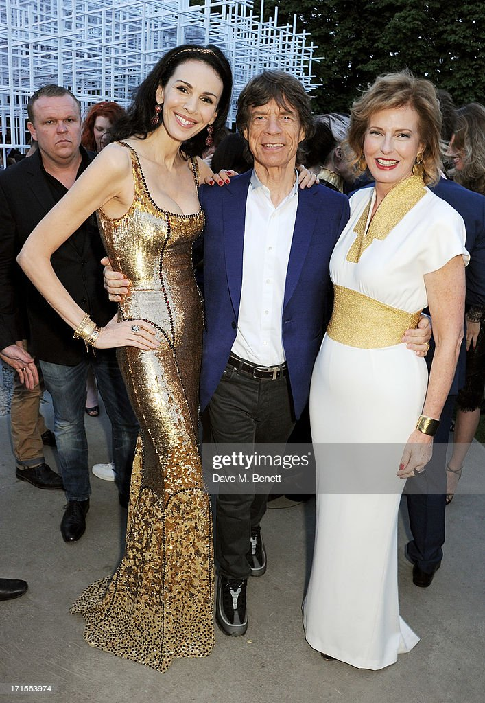 L'Wren Scott, Mick Jagger and Co-director of the Serpentine Gallery Julia Peyton-Jones attend the annual Serpentine Gallery Summer Party co-hosted by L'Wren Scott at The Serpentine Gallery on June 26, 2013 in London, England.
