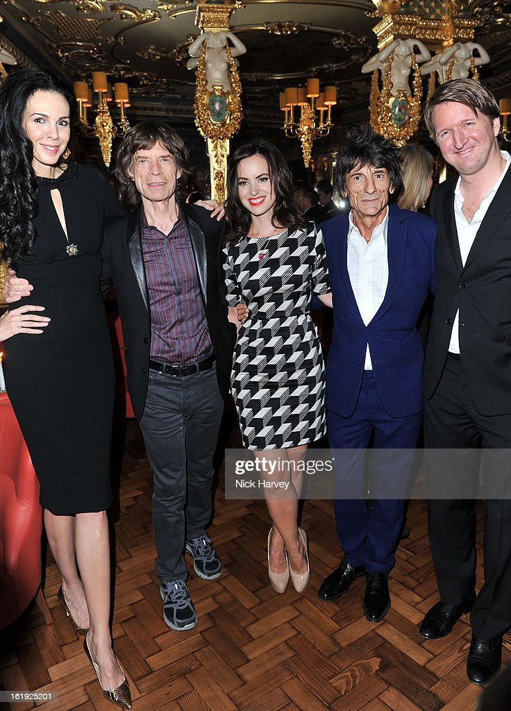 <a gi-track='captionPersonalityLinkClicked' href=/galleries/search?phrase=L%27Wren+Scott+-+Fashion+Designer&family=editorial&specificpeople=566708 ng-click='$event.stopPropagation()'>L'Wren Scott</a>, Sally Humphreys, Ronnie Wood, <a gi-track='captionPersonalityLinkClicked' href=/galleries/search?phrase=Mick+Jagger&family=editorial&specificpeople=201786 ng-click='$event.stopPropagation()'>Mick Jagger</a> and <a gi-track='captionPersonalityLinkClicked' href=/galleries/search?phrase=Tom+Hooper&family=editorial&specificpeople=681836 ng-click='$event.stopPropagation()'>Tom Hooper</a> attend the <a gi-track='captionPersonalityLinkClicked' href=/galleries/search?phrase=L%27Wren+Scott+-+Fashion+Designer&family=editorial&specificpeople=566708 ng-click='$event.stopPropagation()'>L'Wren Scott</a> cocktail party during London Fashion Week Fall/Winter 2013/14 at on February 17, 2013 in London, England.