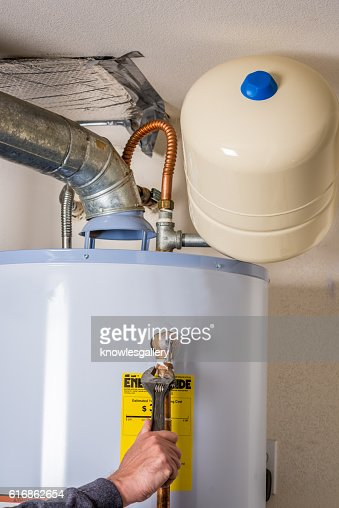 Wrench used to work on a water heater : Stock Photo