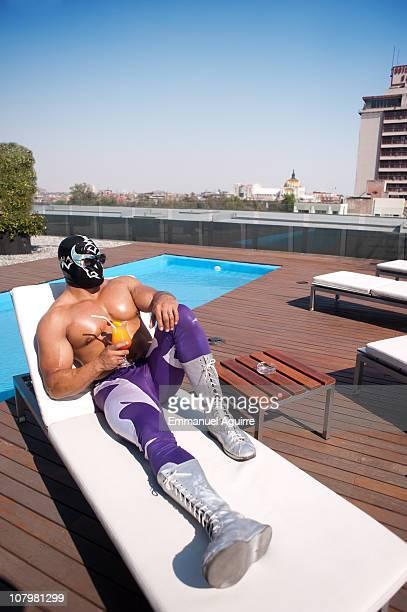 Wresthler relaxing on deck chair
