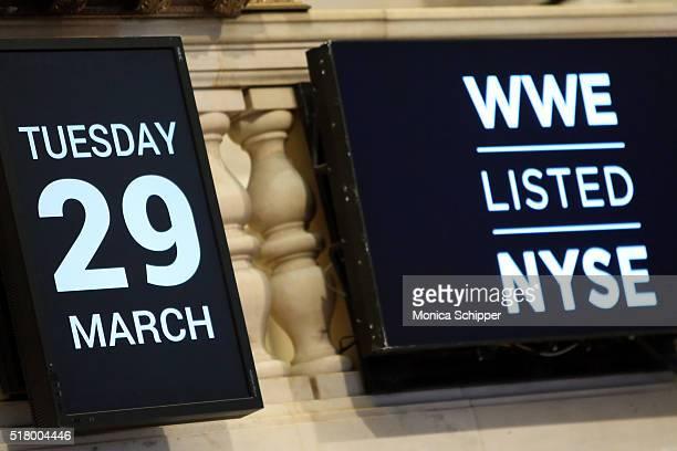Wrestlemania signage displayed at the NYSE as WWE professional wrestlers Erick Rowan Bray Wyatt and Braun Strowman attend WWE WrestleMania Stars Ring...
