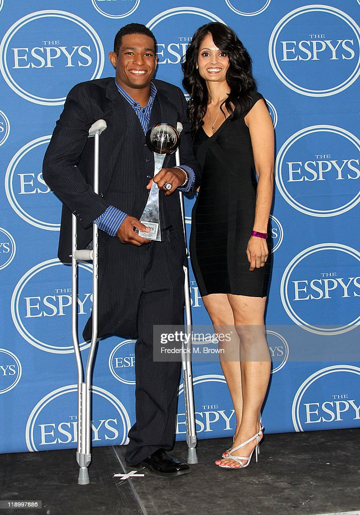 Wrestler Arizona State Anthony Robles with mother Judy Robles posing in the press room at The 2011 ESPY Awards at Nokia Theatre L.A. Live on July 13, 2011 in Los Angeles, California.