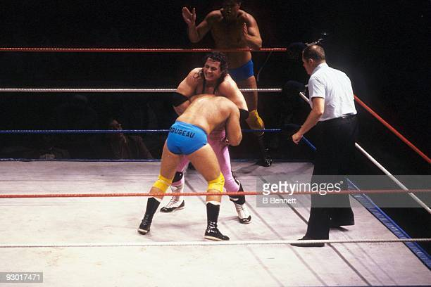 WWF Wrestler Bret 'Hit Man' Hart puts a head lock on Raymond Rougeau during a WWF match on July 17 1987 at Nassau Coliseum in New York New York