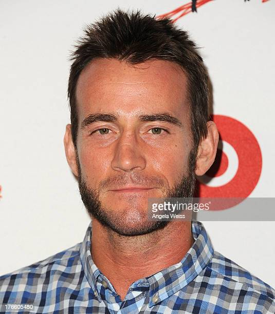 WWE wrestler CM Punk arrives at WWE and E Entertainment's 'Superstars For Hope' at Beverly Hills Hotel on August 15 2013 in Beverly Hills California